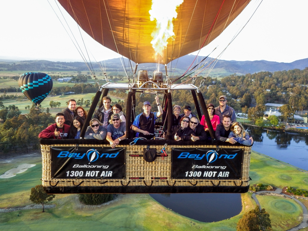 Passengers enjoying a sunrise balloon flight with Beyond Ballooning
