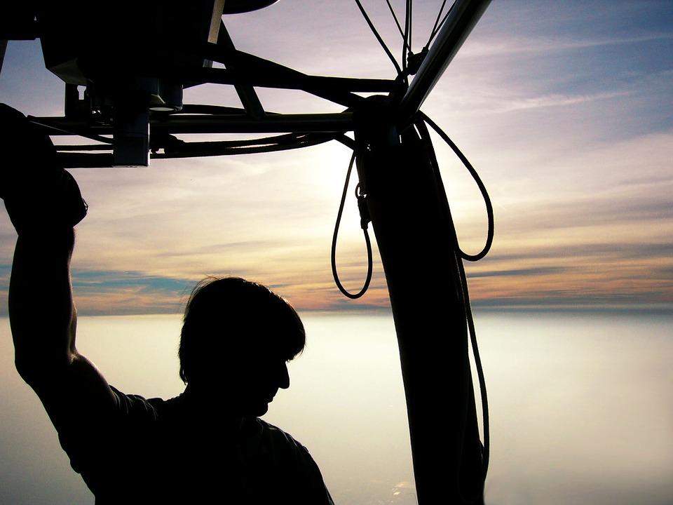Man Riding on a Hot Air Baloon
