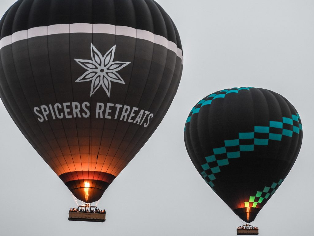 spicers retreats and black and blue balloon flying